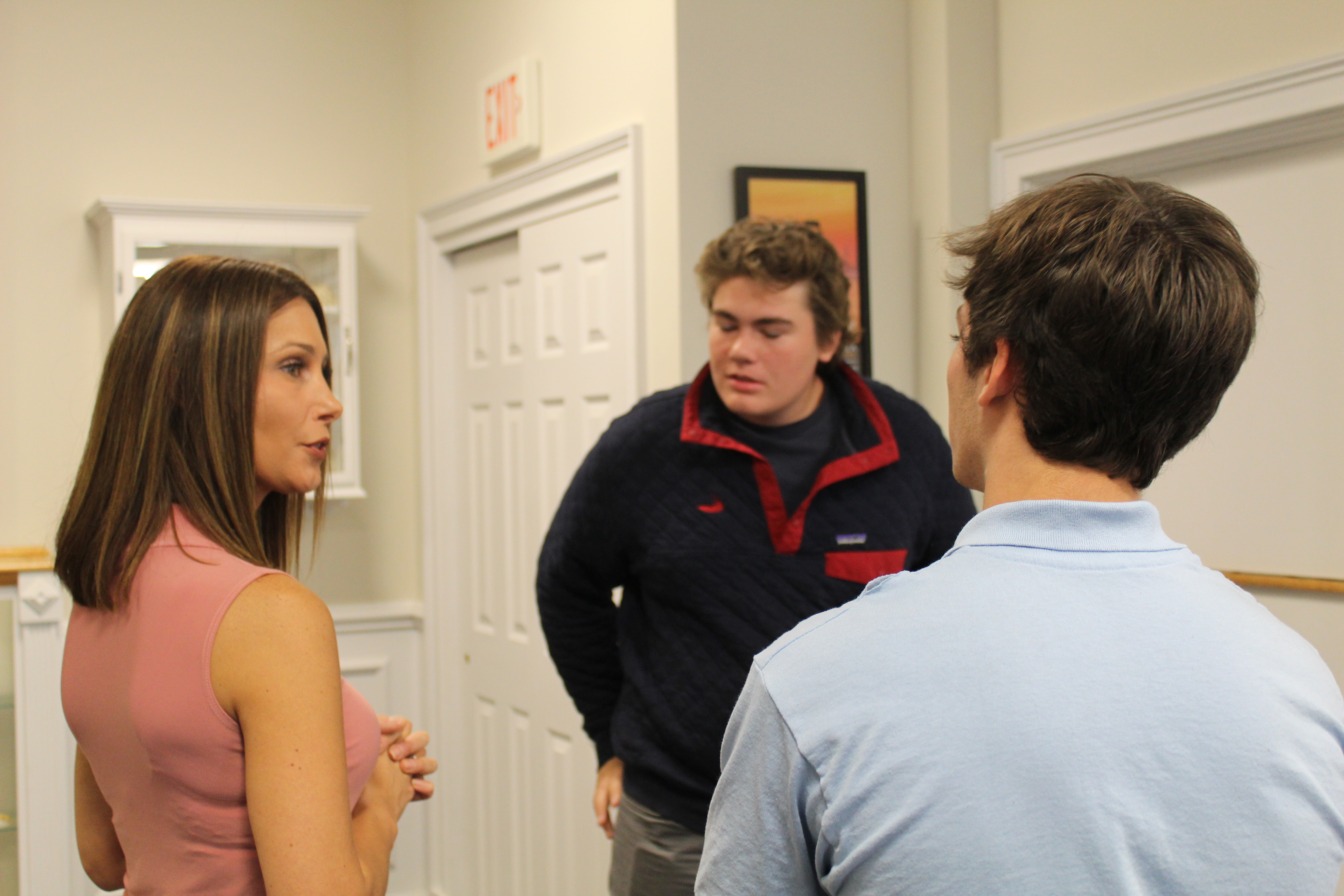 Talking to perspective students at open house